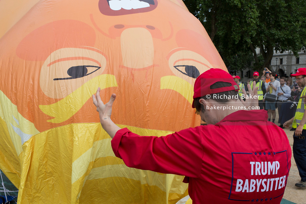 The inflatable balloon called Baby Trump is almost readt to fly above Parliament Square in Westminster, the seat of the UK Parliament, during the US President's visit to the UK, on 13th July 2018, in London, England. Baby Trump is a 20ft high orange blimp depicting the US President as an enraged, smartphone-clutching infant - and given special permission to appear above the capital by London Mayor Sadiq Khan because of its protest rather than artistic nature. It is the brainchild of Graphic designer Matt Bonner.