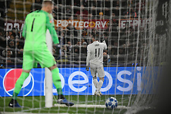 November 27, 2018 - Rome, Italy - Real Madrid's Welsh forward Gareth Bale (R) celebrates after opening the scoring as AS Roma Swedish goalkeeper Robin Olsen reacts during the Champions league football match between AS Roma  and Real Madrid at Olimpico stadium in Rome, Italy, on November 27, 2018. (Credit Image: © Federica Roselli/NurPhoto via ZUMA Press)