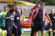 Scunthorpe United defender Cameron Borthwick-Jackson (3) on a stretcher during the EFL Sky Bet League 1 match between AFC Wimbledon and Scunthorpe United at the Cherry Red Records Stadium, Kingston, England on 15 September 2018.