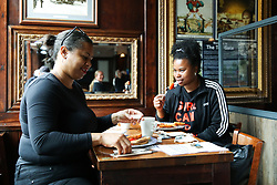 © Licensed to London News Pictures. 04/07/2020. London, UK. Customers having breakfast at THE TOLL GATE,  a Wetherspoon pub in north London which reopened on Super Saturday. Cafes, restaurants, pubs and hairdressers across the UK closed on 23 March following the coronavirus lockdown. As restrictions are eased, cafes, restaurants, pubs and hairdressers reopens today. Photo credit: Dinendra Haria/LNP