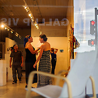 071214       Cable Hoover<br /> <br /> Art123 Gallery patrons peruse the artwork on display during ArtsCrawl in downtown Gallup Saturday.