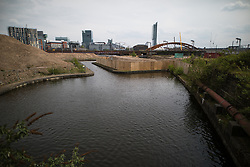 © Licensed to London News Pictures . 30/04/2017 . Salford, UK . GV of the adjacent canal . Homeless men are living in a towpath tunnel in Saford , in the shadow of the Ordsall Chord railway link and a large , Chinese-backed housing development. Photo credit : Joel Goodman/LNP