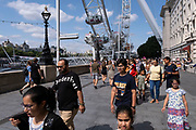 With many people and families staying in the UK for their Summer break during the school holidays, a large number of domestic tourists, who may normally have been travelling abroad, have decended on the capital to see the sights, as seen here on the South Bank near the London Eye on 11th August 2021 in London, United Kingdom. Following the Coronavirus / Covid-19 health scare of the last two years, and with some travel restrictions still in place, more people have chosen a staycation which is a holiday spent in ones home country rather than abroad, or one spent at home and involving day trips to local attractions.