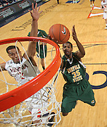 Dec. 20, 2010; Charlottesville, VA, USA; Norfolk State Spartans guard/forward Chris McEachin (35) takes the ball to the hoop in front of Virginia Cavaliers guard Mustapha Farrakhan (2) during the game at the John Paul Jones Arena. Virginia won 50-49. Mandatory Credit: Andrew Shurtleff