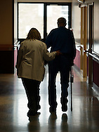 Physical therapy assistant Ellen Dunn walks with a resident at the Valley View Center for Nursing Care and Rehabilitation on Goshen. March 21, 2011.
