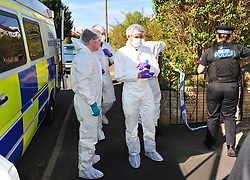 © Licensed to London News Pictures. 29/09/2018<br /> HADLOW, UK.<br /> Police forensics.<br /> A murder investigation has been launched in Hadlow,Kent after the deaths of two women at Carpenters Lane. A 28 year old man has been arrested on suspicion of murder after three people suffered serious injuries. Police forensic officers are at the scene inside two properties 26 and 24 Carpenters Lane.<br /> Photo credit: Grant Falvey/LNP