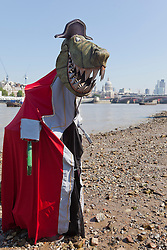 © Licensed to London News Pictures. 28 August 2013. London, England. The pirate dinosaur crew from Captain Flinn and the Pirate Dinosaurs arrive on  the Southbank from the Edinburgh Festival for performances at the London Wonderground from 28 August to 8 September 2013. The crew of this children's theatre show is captained by Mr T, a 10 foot Pirate Captain Tyrannous Rex. Photo credit: Bettina Strenske/LNP