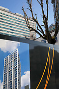 A graphic showing a future apartment high-rise to be built by housing trust Notting Hill Genesis, is seen on the construction site hoarding, beneath older, ugly architecture, on 21st January 2020, in Croydon, London, England.