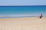 Israel. Haifa, Dado Beach, lone man on beach