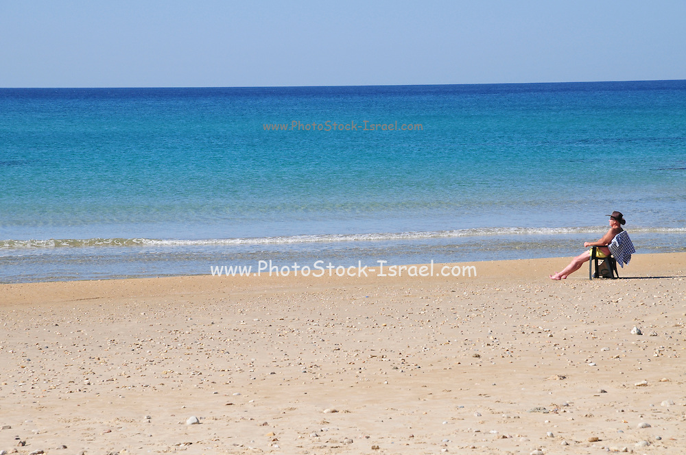 Israel. Haifa, Dado Beach, lone man on beach