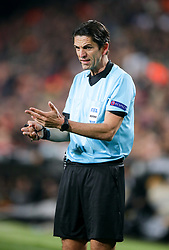 Referee Deniz Aytekin gestures on the pitch