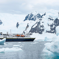 View of the National Geographic Explorer anchored amidst icebergs near Danco Island in Antarctica.