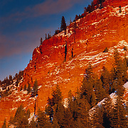 the moon rises as the sunsets over Bellyache Mountain in winter Eagle River, Eagle, Colorado