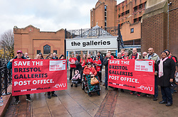 © Licensed to London News Pictures. 01/12/2018. Bristol, UK. Bristol's elected Mayor MARVIN REES (third from right) at the Save Our Post Offices campaign event at Bristol's main post office which under threat of closure in The Galleries Shopping Centre. Members of the Communication Workers Union (CWU) supported by Bristol Trades Union Council were joined by Bristol's elected Mayor Marvin Rees to campaign against the proposed closure. This is part of a national campaign day, Saturday 01 December, to save Crown Post Offices from closure. Bristol's main Post Office in The Galleries shopping centre is on the list of regional closures along with the main Post Offices in Bath and Gloucester, with services due to be transferred to post office counters in branches of WH Smiths under a franchise arrangement. And in Kingswood the post office which moved to WH Smith last year would transfer to be operated directly by WH Smiths with Post Office workers becoming Smiths' employees. It is feared while fully trained Post Office counter staff should be moved across and retain their £12-an-hour salaries, any new staff would be employed by WHSmith at the minimum wage. The campaign has been launched by the CWU in response to the announcement that 74 Crown offices are to be franchised (privatised) to high-street retailer WH Smith – a move which will impact some 800 jobs and drastically cut services to communities. Photo credit: Simon Chapman/LNP