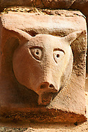 Norman Romanesque exterior corbel no 27 - sculpture of a pigs head. Pigs signify sinners, the unclean and heretics as well as carnal feelings, it is therefore a morality figure. The Norman Romanesque Church of St Mary and St David, Kilpeck Herefordshire, England. Built around 1140 .<br /> <br /> Visit our MEDIEVAL PHOTO COLLECTIONS for more   photos  to download or buy as prints https://funkystock.photoshelter.com/gallery-collection/Medieval-Middle-Ages-Historic-Places-Arcaeological-Sites-Pictures-Images-of/C0000B5ZA54_WD0s