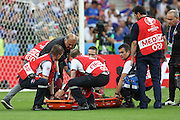 Portugal Forward Cristiano Ronaldo has his hands over his face on a stretcher during the Euro 2016 final between Portugal and France at Stade de France, Saint-Denis, Paris, France on 10 July 2016. Photo by Phil Duncan.
