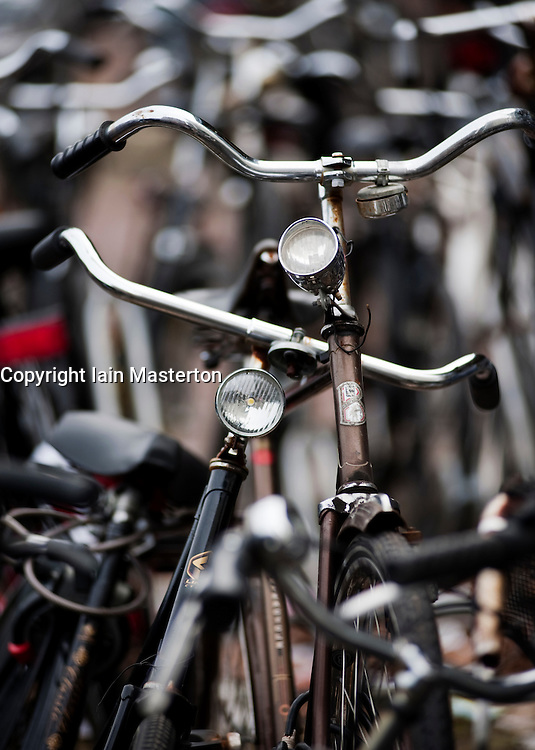 Many bicycles parked outside station in the Netherlands