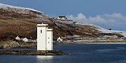 A view of the Port Ellen lighthouse from the deck of the Islay ferry