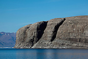 Hans Island, a tiny disputed island between Greenland and Canada, situated in the Kennedy Channel of Nares Strait, between Greenland and Ellesmere Island. Hans Island has been the centre of an ongoing, and often surreal territorial dispute between Canda and Denmark, with various officials from both nations taking turns to plant flags on the island. In April 2012, it was announced that the two nations would sign an agreement to split the little 1.3 sq km island in two. The island is named after Hans Hendrik AKA Heindrich, a famous Greenlandic explorer who was also known as Suersaq.