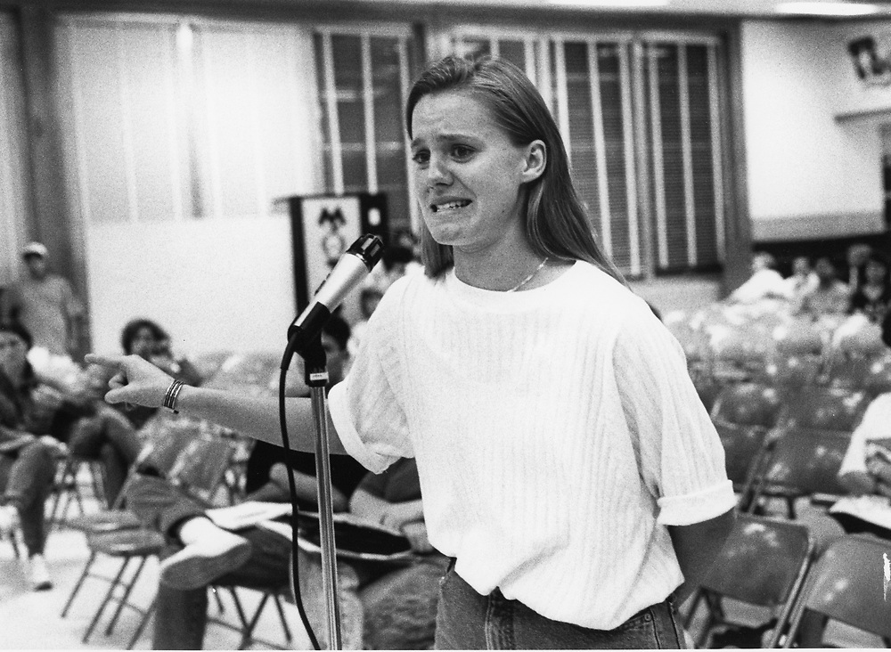 ©1991 PUBLIC SPEAKING: Parents speak out at school board special meeting about closing Travis High School, Austin, Texas.