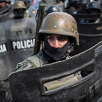 Army, Police, Military Police and Navy on riot patrol in Tegucigalpa. Most cover their face with a balaclava, they have no visible ID and they often travel in unmarked cars without number plates.