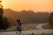 UNITED KINGDOM, London: 25 June 2020 <br /> A cyclist makes his way through Richmond Park, London in the early morning sun this morning. Temperatures have soared over the last few days and are expected to reach up to 34C degrees today, with possibly the highest ever UV levels being recorded.