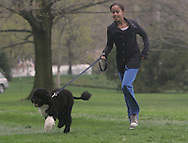 MaliaObama takes BO, the First Dog, on a romp on the South Lawn of the White House. Photo by Dennis Brack