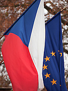 The flag of Czech Republic and the European Union on a building in Prague.