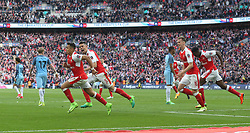 23 April 2017 FA Cup semi-final : Arsenal v Manchester City :<br /> Gabriel chases after Alexis Sanchez to celebrate the second goal for Arsenal.<br /> Photo: Mark Leech