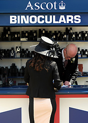 © Licensed to London News Pictures. 19/06/2012. Ascot, UK  A woman at a binocular store. Day one at Royal Ascot 19 June 2012. Royal Ascot has established itself as a national institution and the centrepiece of the British social calendar as well as being a stage for the best racehorses in the world.. Photo credit : Stephen Simpson/LNP