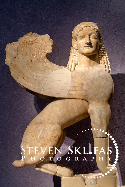 6th century BC marble winged sphinx at the Kerameikos museum. Athens. Greece. Found buried near the Sacred gate in 2002, the archaic era votive offering or funerary sculpture statue would have crowned a grave stele. Serving as a burial ground as long ago as the 12th century BC, Kerameikos located in the ancient neighbourhood of potters contains part of the ancient city walls and the Dipylon, the main gate of Ancient Athens at a junction of the Sacred Way and Panathenaic Way. It served as a burial ground for the richest and most distinguished citizens of the city.