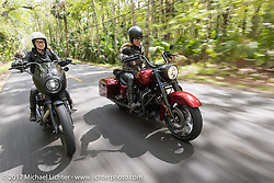 """Iron Lilies Leticia Cline (R) tests the all new 2017 Harley-Davidson Road King Special with its 107"""" Milwaukee-Eight engine alongside Kristen Lassen on a 2014 Harley-Davidson Iron 883 Sportster in Tomoka State Park during Daytona Beach Bike Week. FL. USA. Tuesday, March 14, 2017. Photography ©2017 Michael Lichter."""