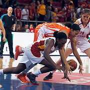 Galatasaray's Melisa CAN (L), Saziye IVEGIN (R) and UMMC Ekaterinburg's Candace PARKER (C) during their Euroleague woman Group A basketball match Galatasaray between UMMC Ekaterinburg at the Abdi Ipekci in Istanbul at Turkey on wednesday,October, 26, 2010. Photo by TURKPIX