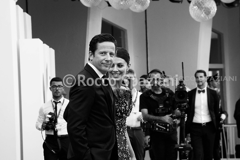 """VENICE, ITALY - AUGUST 28: Ross McCall and Festival hostess Alessandra Mastronardi walk the red carpet ahead of the Opening Ceremony and the """"La Vérité"""" (The Truth) screening during the 76th Venice Film Festival at Sala Grande on August 28, 2019 in Venice, Italy."""