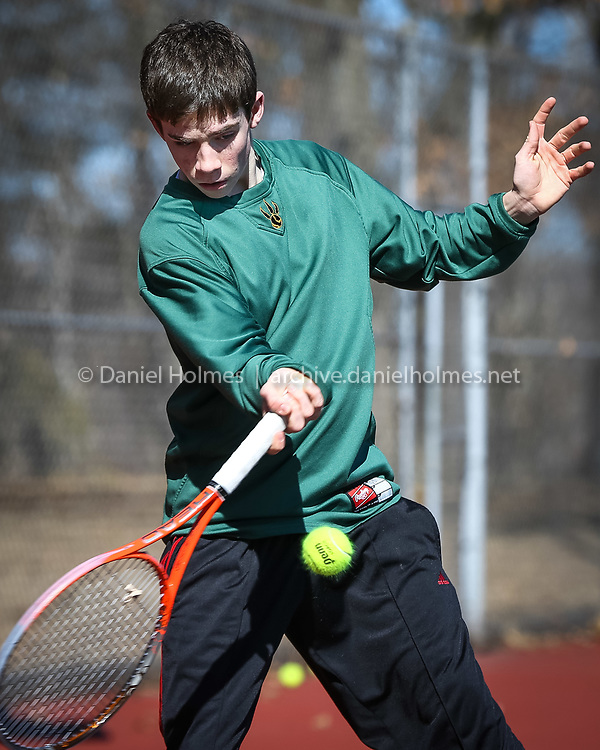 (3/24/14, FRAMINGHAM, MA) Sophomore Drew Coleman volleys with a teammate during tennis practice at Framingham High School on Monday. Daily News and Wicked Local Photo/Dan Holmes