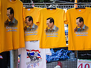 05 DECEMBER 2013 - BANGKOK, THAILAND: Tee shirts with a portrait of the King on them for sale at the King's Birthday. Thais observed the 86th birthday of Bhumibol Adulyadej, the King of Thailand, their revered King on Thursday. They held candlelight services throughout the country. The political protests that have gripped Bangkok were on hold for the day, although protestors did hold their own observances of the holiday. Thousands of people attended the government celebration of the day on Sanam Luang, the large public space next to the Grand Palace in Bangkok.     PHOTO BY JACK KURTZ