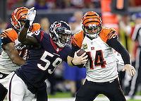 Cincinnati Bengals quarterback Andy Dalton (14) is sacked by Houston Texans outside linebacker Whitney Mercilus (59) during the second half of an NFL football game Saturday, Dec. 24, 2016, in Houston. (AP Photo/Sam Craft)