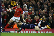 Josh Adams of Wales is tackled by Byron McGuigan of Scotland as he breaks for the try line. Wales v Scotland, NatWest 6 nations 2018 championship match at the Principality Stadium in Cardiff , South Wales on Saturday 3rd February 2018.<br /> pic by Andrew Orchard, Andrew Orchard sports photography