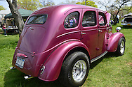 This red 1948 Anglia Perfect car, belonging to Bill Sala of Floral Park, is at the Antique Auto Show, where New York Antique Auto Club members exhibited their cars on the farmhouse grounds of Queens County Farm Museum.