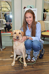 EVEIE LONGDON and her dog Bear at a party hosted by Lulu Guinness and Daphne's to launch Lulu's Designer Dog Bowl and to mark Daphne's allowing dogs through it's doors, held at Daphne's, Draycott Avenue, London on 28th June 2016.