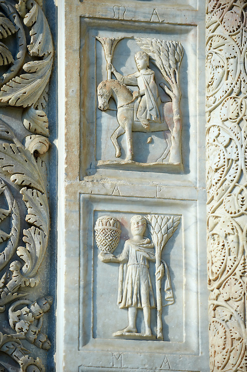 Medieval Sculptures of the Door of the Bapistry of Pisa, Italy . The Pisa Baptistery of St. John is a Roman Catholic ecclesiastical building in Pisa, Italy. Construction started in 1152 to replace an older baptistery, and when it was completed in 1363, it became the second building, in chronological order, in the Piazza dei Miracoli, near the Duomo di Pisa . The largest baptistery in Italy, it is 54.86 m high, with a diameter of 34.13 m. The Pisa Baptistery is an example of the transition from the Romanesque style to the Gothic style: the lower section is in the Romanesque style, with rounded arches, while the upper sections are in the Gothic style, with pointed arches. The Baptistery is constructed of marble, as is common in Italian architecture.