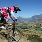 Kaytee Campbell from Ngaruawahia in action in the Open Women competition during the NZBNZ South Island Downhill Cup mountain bike downhill series held on The Remarkables face with a stunning backdrop of the Wakatipu Basin. 150 riders took part in the two day event.  Queenstown, Otago, New Zealand. 9th January 2012. Photo Tim Clayton