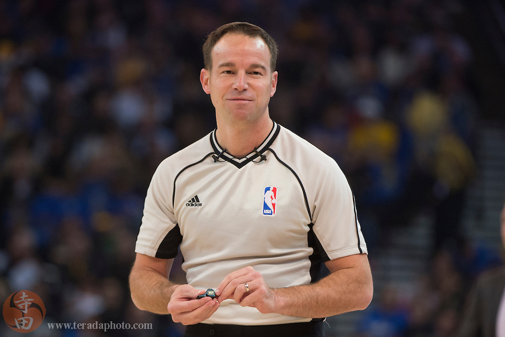 November 17, 2015; Oakland, CA, USA; NBA referee Josh Tiven (58) during the first quarter between the Golden State Warriors and the Toronto Raptors at Oracle Arena. The Warriors defeated the Raptors 115-110.