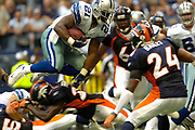 Dallas Cowboys running back Julius Jones (21) leaps for a gain against Denver Broncos cornerback Champ Bailey (24), among others, in an NFL preseason game Saturday August 18,2007 at Texas Stadium in Irving, Texas. Photo: Jaime R. Carrero/Tyler Morning telegraph