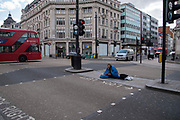 A homeless man begs at a Oxford Street pedestrian crossing on 6th April 2020 in London, United Kingdom. There have been almost 50,000 reported cases of the COVID-19 coronavirus in the United Kingdom and almost 5,000 deaths. The country is in its third week of lockdown measures aimed at slowing the spread of the virus.