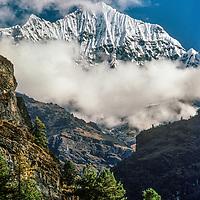 Mount Kusum Khangri overlooks a pine forest in the Dudh Kosi gorge,  Khumbu Region of Nepal.