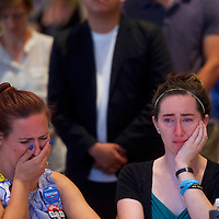 PHILADELPHIA, PA- July 26, 2016.  From left, Jessica Fears and Jesica Butler cry as Bernie Sanders addresses Iowa delegates at the Marriott Downtown Hotel on the second day of the Democratic National Convention in Philadelphia, PA on July 26, 2016.  CREDIT: Mark Makela for The New York Times      NYTDNC
