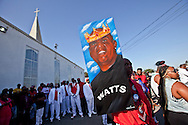 """A man carries a painting of Kevin.<br /> Funeral services for Kevin """"Flipside"""" White at Macedonia Church in Watts.<br /> White was shot dead in what is believed to be an unprovoked attack during a gang conflict at Watts' Nickerson Gardens and Jordan Downs housing projects.<br /> Flipside, 44, was a founding member of Watts' first major label hip hop act, O.F.T.B. (Operation From The Bottom)."""