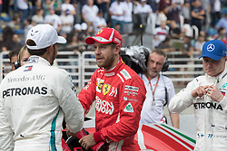 November 10, 2018 - Sao Paulo, Sao Paulo, Brazil - LEWIS HAMILTON (L), pole position and SEBASTIAN VETTEL,  after the qualifying session to the Formula One GP Brazil 2018 at Interlagos circuit, in Sao Paulo, Brazil. The grand prix will be celebrated next Sunday, November 11. (Credit Image: © Paulo LopesZUMA Wire)
