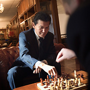 Kirsan Ilyumzhinov, 44, president of the southern Russian republic Kalmykia, plays chess in his representative office in Moscow...Ilyumzhinov, who is also the president of the World Chess Federation, Fide, is hosting one of the world?s most important matches in history. ..The match beginning September 21 in Elista, the capital of Europe?s only Buddhist nation, will end a 13-year split in the game that has produced rival claims to the title. ..Veselin Topalov, a Bulgarian ranked first according to Fide, will play against Vladimir Kramnik, who is the Classical Chess World Champion, a title established after Garry Kasparov led a breakaway from Fide in 1993. The two grandmasters, both aged 31, will face each other for the right to be undisputed world chess champion...A Buddhist millionaire businessman, Ilyumzhinov acquired his wealth in the economic free-for-all which followed the collapse of the Soviet Union. ..At the age of just over 30, he was elected president in 1993 after promising voters $100 each and a mobile phone for every shepherd. Soon after, he introduced presidential rule, concentrating power in his own hands. ..He denies persistent accusations of corruption, human rights abuses and the suppression of media freedom. When Larisa Yudina, editor of the republic's only opposition newspaper and one of his harshest critics, was murdered in 1998, he strenuously rejected allegations of involvement. ..Mr Ilyumzhinov has been president of the International Chess Federation (FIDE) since 1995 and has been enthusiastic about attracting international tournaments to Kalmykia. His extravagant Chess City has led to protests by its impoverished citizens. .